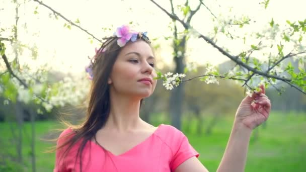 young female tasting the flavour of spring blossom slow motion