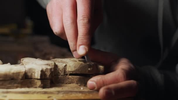 Close up of joiner working with wood frame slow motion