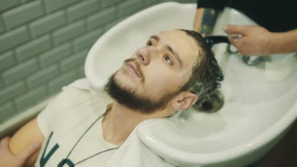 Barber wash customer hair