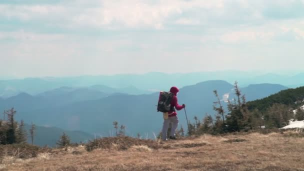 hiker trekking in the mountains slow motion