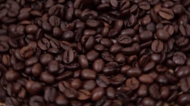 roasted coffee beans, close-up of coffee beans. falling coffee beans selective focus. slow mo