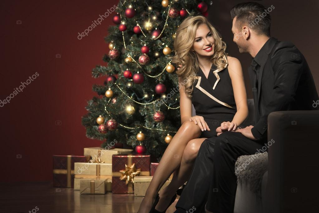 happy young people give each other gifts near the christmas tree stock photo aarrttuurr