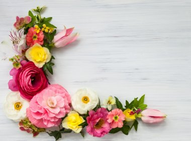 Flowers frame on white