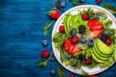 Salad leaves with berries, avocado