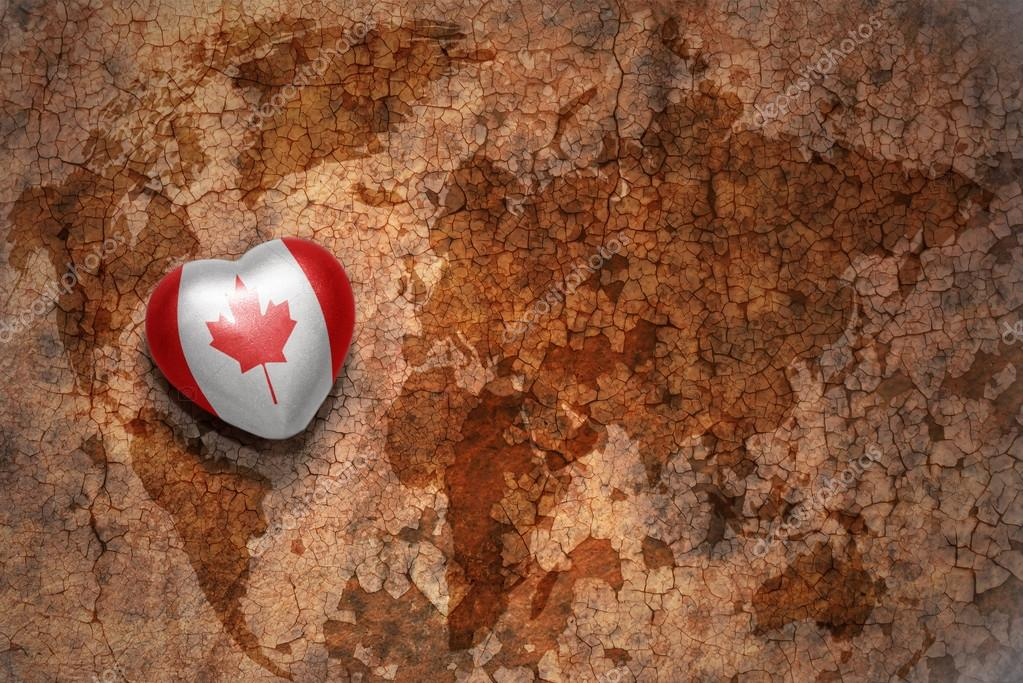 Heart with national flag of canada on a vintage world map crack heart with national flag of canada on a vintage world map crack paper background concept gumiabroncs Image collections