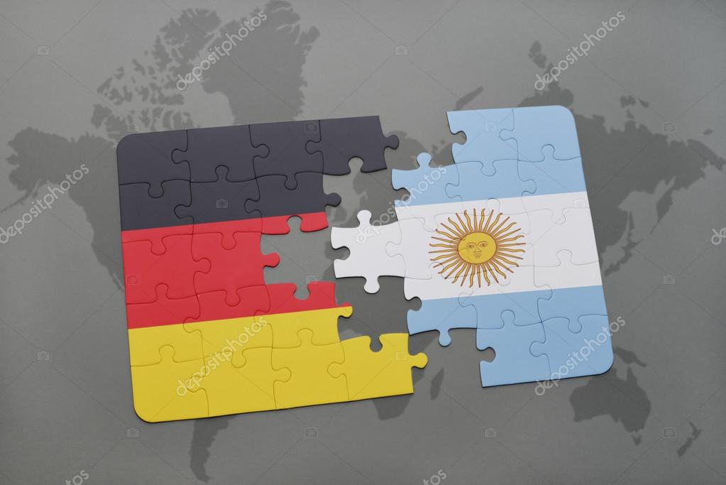 puzzle with the national flag of germany and argentina on a world ...