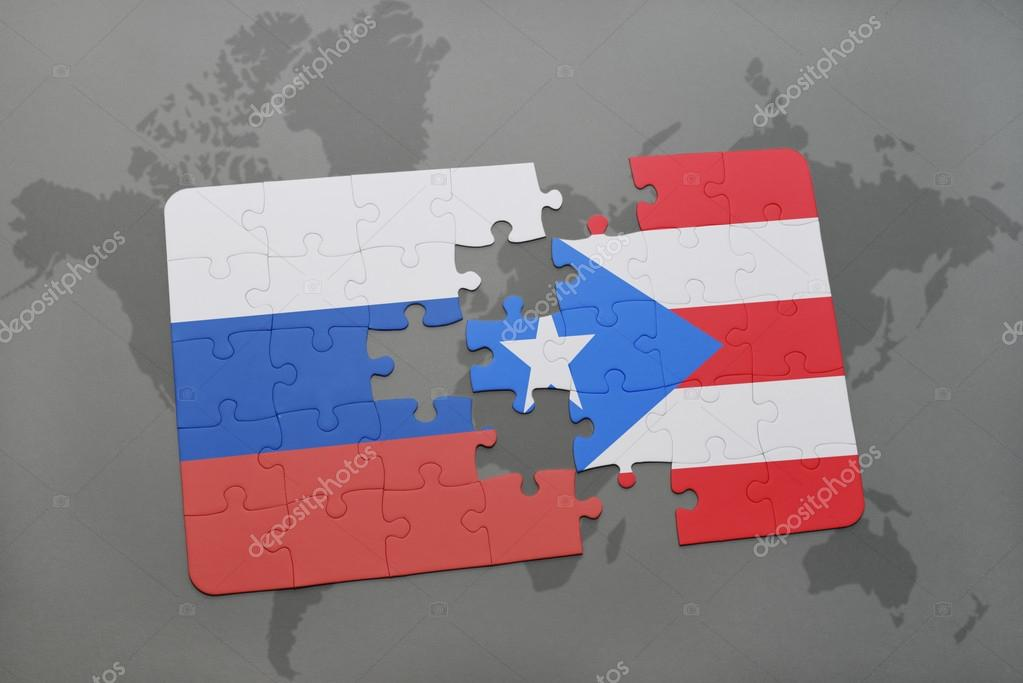 puzzle with the national flag of russia and puerto rico on a world