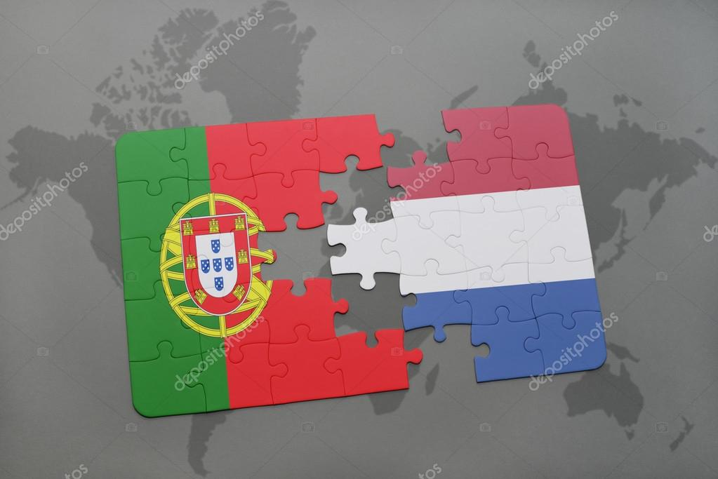 puzzle with the national flag of portugal and netherlands on a world ...