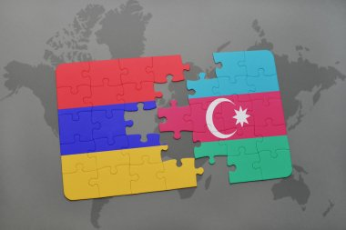 puzzle with the national flag of armenia and azerbaijan on a world map background.