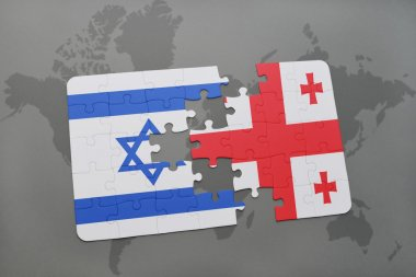 puzzle with the national flag of israel and georgia on a world map background.