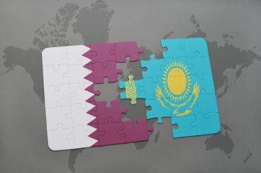 puzzle with the national flag of qatar and kazakhstan on a world map background.