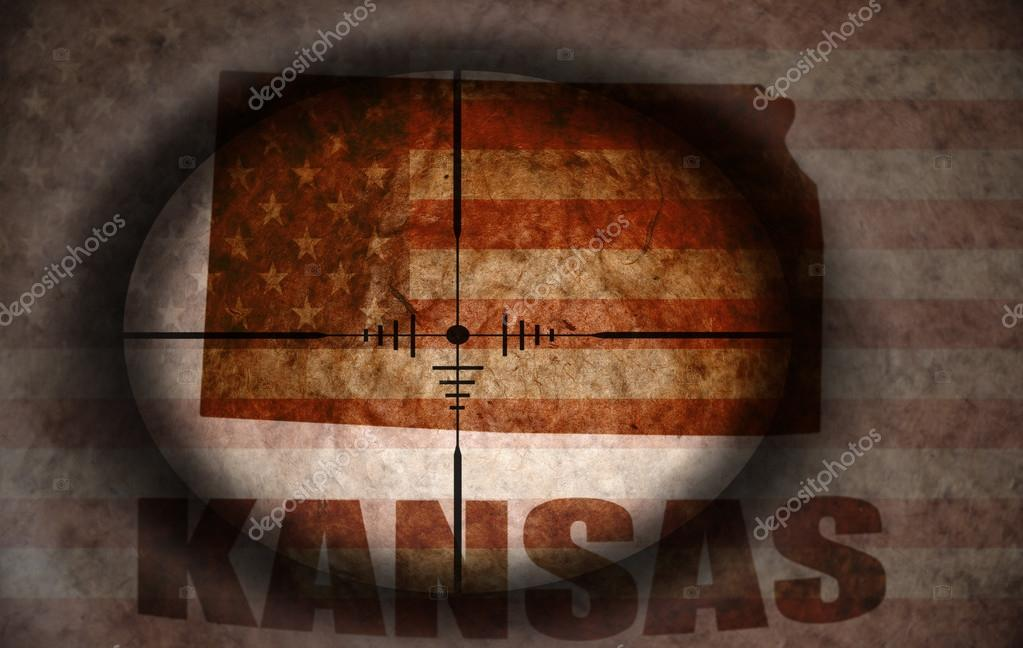 sniper scope aimed at the vintage american flag and kansas state map on vintage stamp seal, vintage map kansas city, vintage nebraska map with towns, vintage overland park maps,