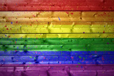painted gay flag on a wooden texture