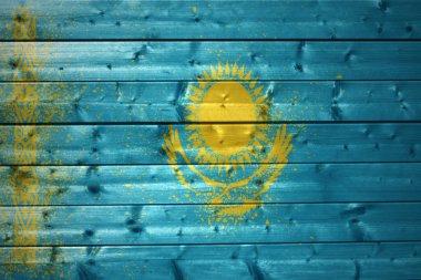 painted kazakhstan flag on a wooden texture