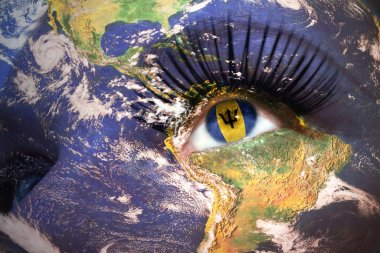 womans face with planet Earth texture and barbados flag inside the eye