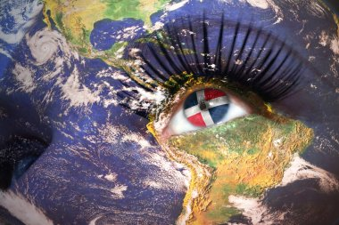 womans face with planet Earth texture and dominican republic flag inside the eye