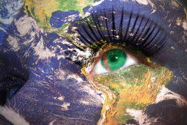 womans face with planet Earth texture and turkmenistan flag inside the eye.