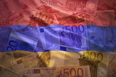colorful waving armenian flag on a euro money background