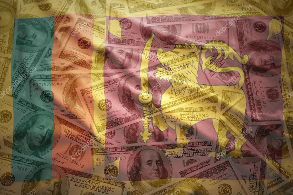 colorful waving sri lanka flag on a american dollar money