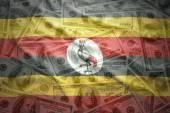 barevné, mává ugandský vlajky na americký dolar peníze pozadí