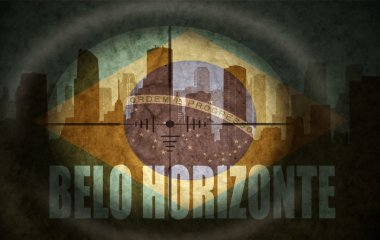 sniper scope aimed at the abstract silhouette of the city with text Belo Horizonte at the vintage brazilian flag