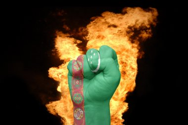 fire fist with the national flag of turkmenistan