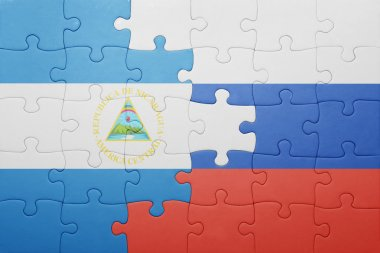 puzzle with the national flag of nicaragua and russia
