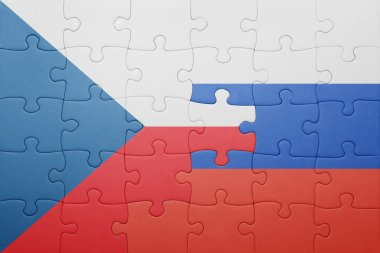 puzzle with the national flag of czech republic and russia