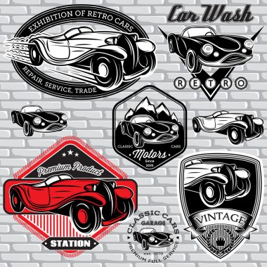 set of emblems with retro car on wall