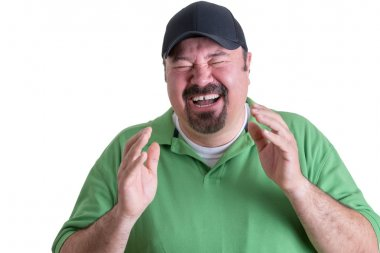 Portrait of Overweight Man Wearing Green Shirt and Black Baseball Cap Laughing Ecstatically in front of White Background, Head and Shoulders Portrait of Joyful Man stock vector