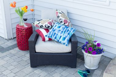 Pile of colorful cushions on an outdoor armchair