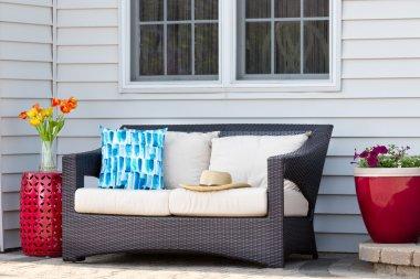 Comfortable outdoor living area on a brick patio