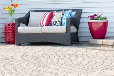 Comfortable modern settee on an outdoor patio