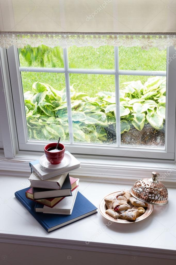 Coffee on Piled Books and Pastries at the Window
