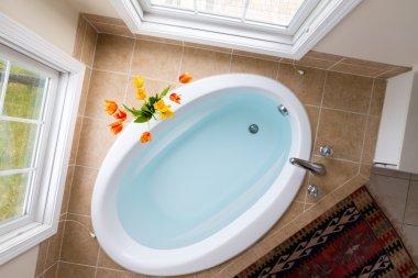 Corner oval bathtub full of clean water
