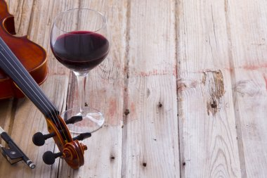 Violin and Wine on Wooden Floor with Copy Space