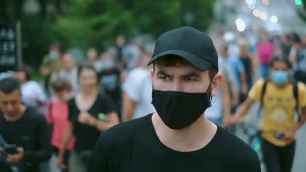 March resistance strike of masked protesting people under lockdown restriction.