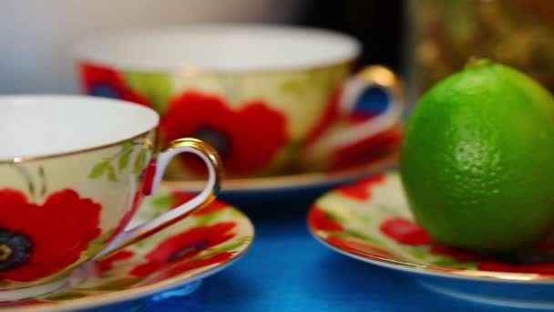 Two Tea cups with green lime near