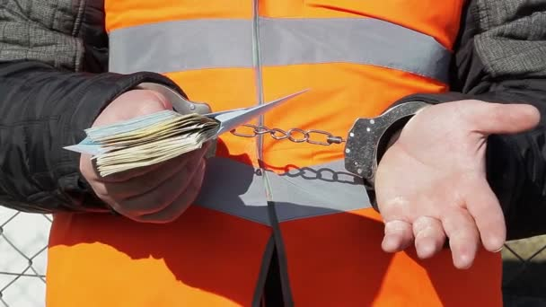 Man in handcuffs with euro banknotes