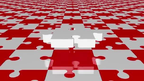 Létající kousek skládačky v bílém na červené a bílé barvy