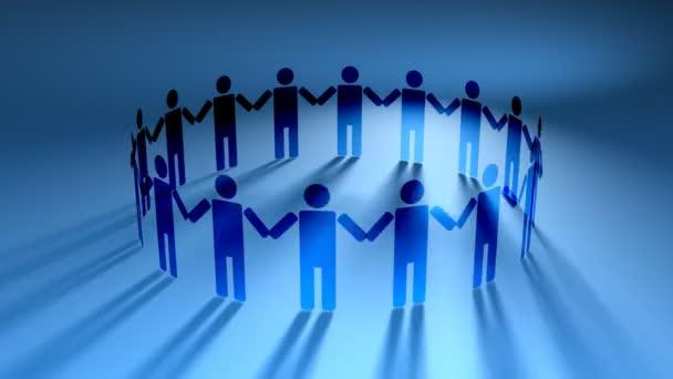 Menschen halten sich im Kreis an den Händen