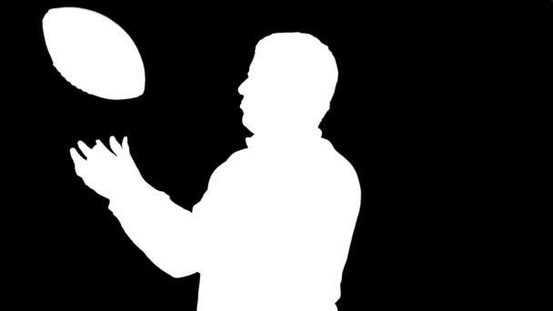 Ember dobott labdarúgó és jelentő (sziluett)