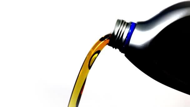Motor Oil Pouring from Plastic Bottle