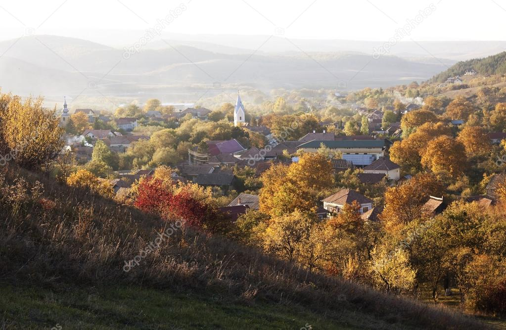Autumn landscape with church in the village