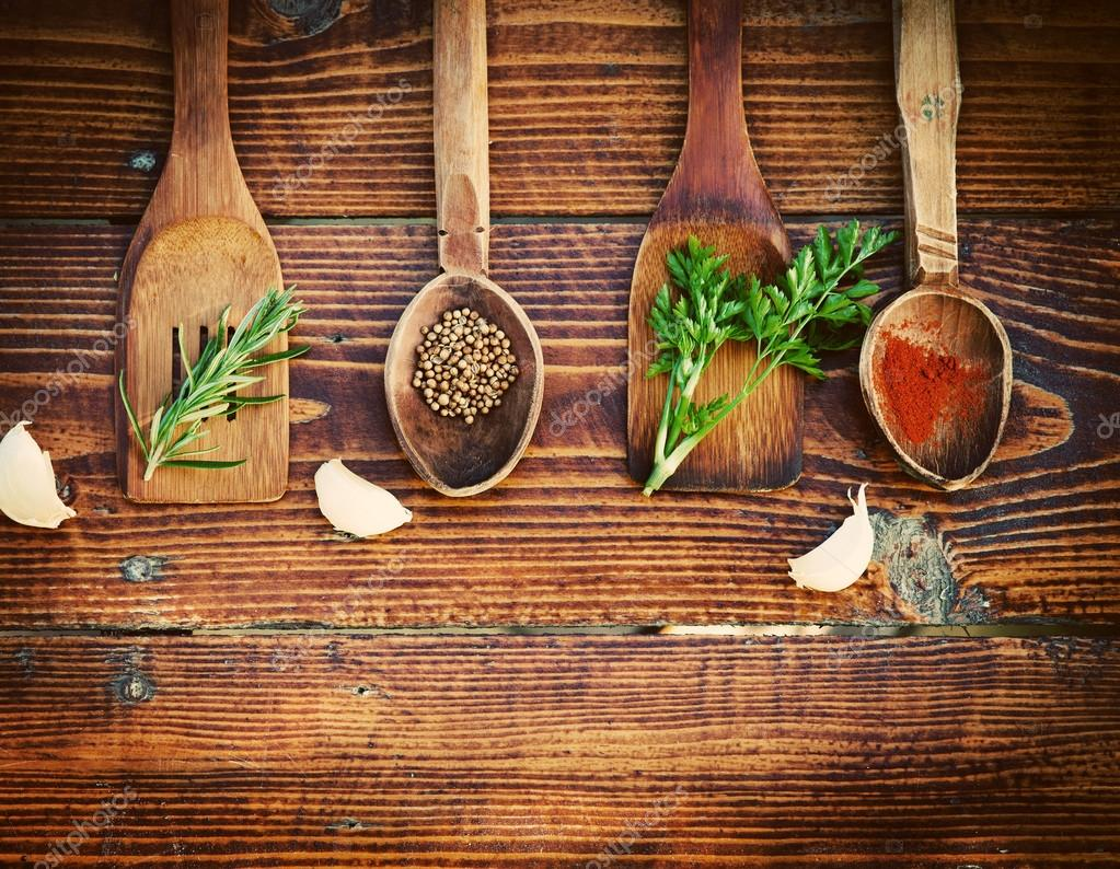 Spices and herbs on wooden table. Top view