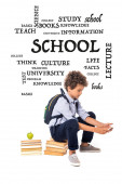 curly schoolboy with backpack sitting on books near apple and lettering while using smartphone on white