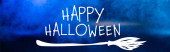 Photo happy halloween lettering on blue dark background with smoke, banner