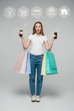 Shocked woman holding smartphones and shopping bags near illustration on grey stock vector
