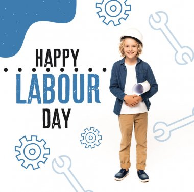 Curly boy in safety helmet and costume of architect holding blueprint near happy labour day lettering on white stock vector