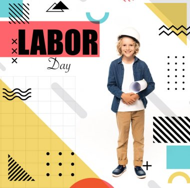 Curly boy in safety helmet and costume of architect holding blueprint near labor day lettering on white stock vector